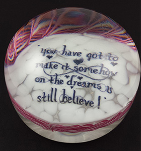 Lyrics from Comes a time by the grateful Dead in a glass paper weight